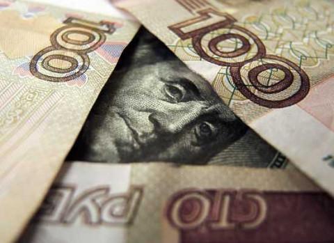 Банк России понизил официальный курс доллара на выходные